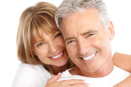 Couple smiling after getting dental implants at Beautiful Smiles in Woodland, CA